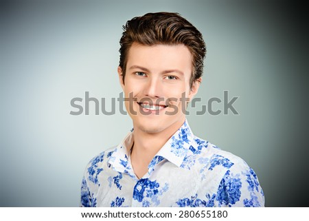 Portrait of a cheerful young man in casual clothes. Men's beauty, fashion. Studio shot. - stock photo
