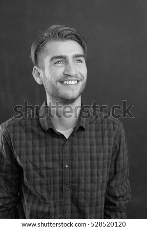 Portrait of a cheerful young man in checkered shirt