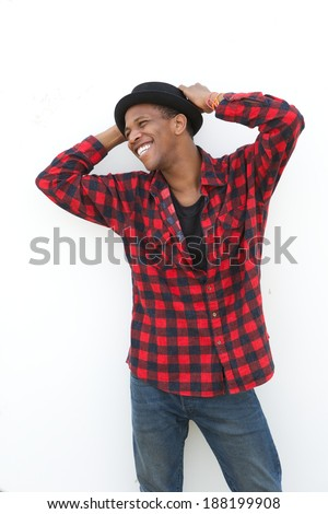 Portrait of a cheerful young man laughing outdoors on white background - stock photo