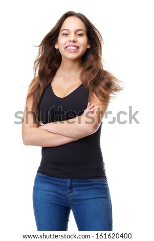 Portrait of a cheerful young woman in casual clothes smiling with arms crossed on isolated white background - stock photo