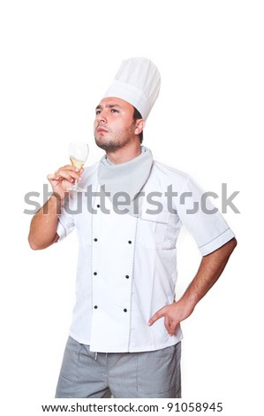 Portrait of a chef holding a glass of wine isolated on white background