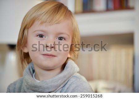 Portrait of a child aged three years old in his house