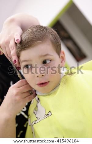 Portrait of a child at hairdresser salon - stock photo