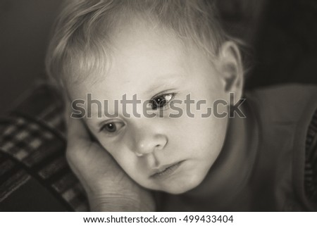 portrait of a child. black and white. sorrow
