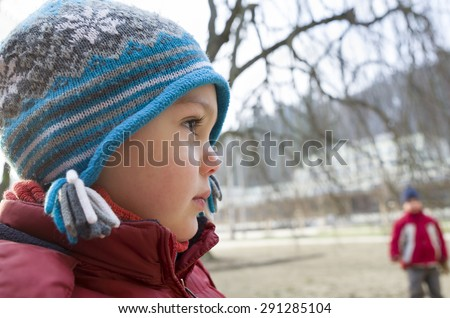 Portrait of a child boy in winter - stock photo