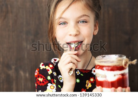 Portrait of a child eating sweet homemade dessert with berries - stock photo