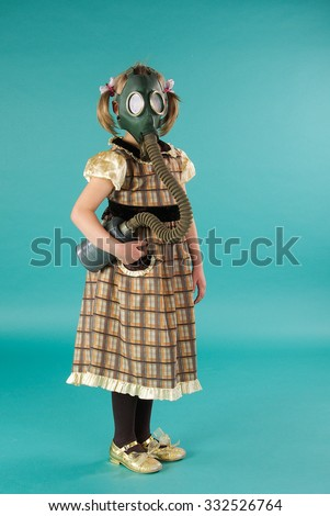 Portrait of a child in pratimoksa. Portrait of a girl in dress and mask on a bright blue background - stock photo