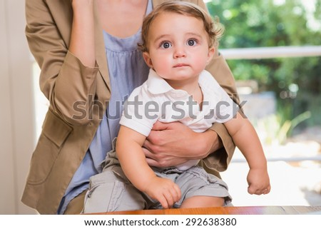 Portrait of a child looking at camera in the office - stock photo