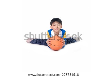 portrait of a child lying down holding a ball isolated on white background