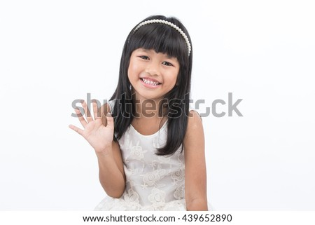 Portrait of a child smiling and waving on white background