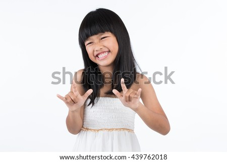 "Portrait of a child smiling using sign language to say ""love"" by hands on white background - stock photo"