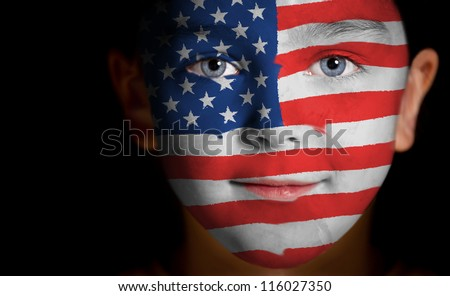 Portrait of a child with a painted American flag, closeup