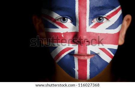 Portrait of a child with a painted British flag, closeup - stock photo