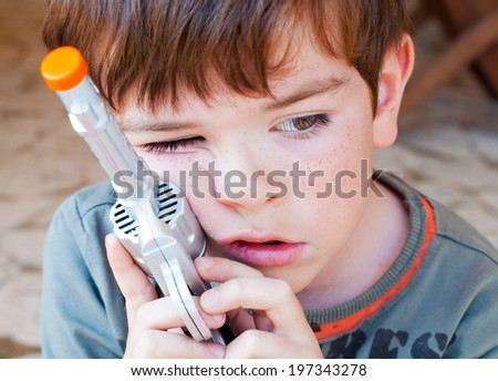 Portrait of a child with a toy gun - stock photo