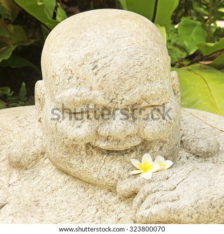 Portrait of a Chinese god  statue stone - stock photo
