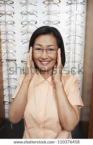 Portrait of a Chinese woman trying glasses at shop