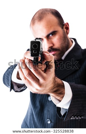 portrait of a classy businessman or mobster or security guard holding a gun isolated over a white background