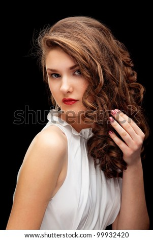 portrait of a close-up brown-haired with beautiful hair in the studio on a black background isolated - stock photo
