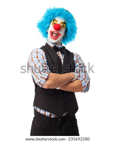 portrait of a clown smiling over white background - stock photo