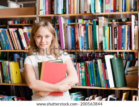 portrait of a college student in library - stock photo