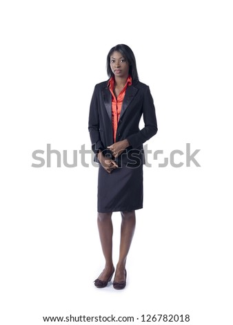 Portrait of a confident African American businesswoman standing over white background - stock photo