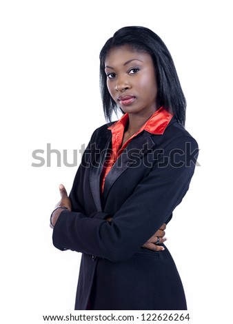 Portrait of a confident African American businesswoman with arms crossed over white background - stock photo