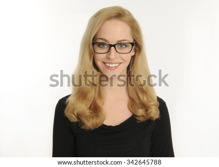 portrait of a confident and beautiful blonde woman, wearing thick rimmed black glasses.  smiling while looking at camera. isolated on white background.
