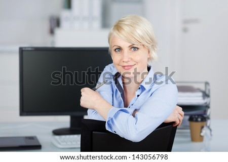 Portrait of a confident and beautiful young businesswoman looking at camera - stock photo