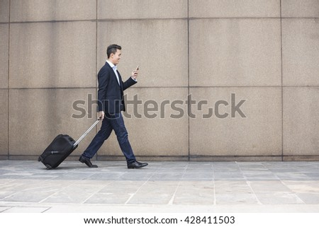 Portrait of a confident asian businessman walking in the city.