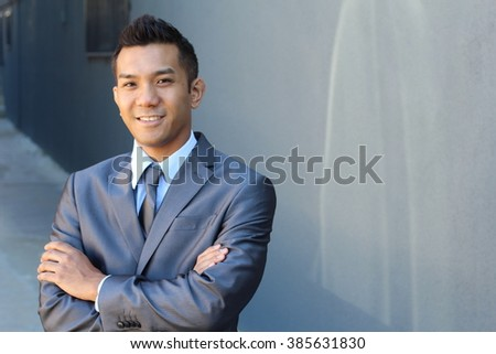 Portrait of a confident Asian lawyer outside - stock photo