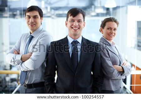 Portrait of a confident business team looking at camera and smiling
