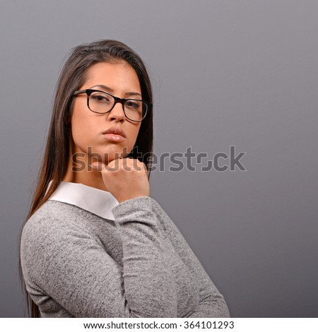 Portrait of a confident business woman against gray background