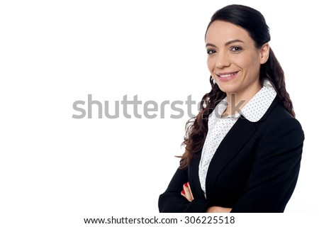Portrait of a confident business woman with folded arms - stock photo