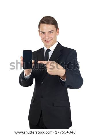 Portrait of a confident businessman holding a smartphone on  isolated background