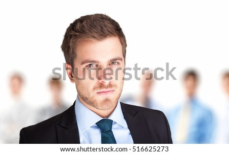 Portrait of a confident businessman in front of his team