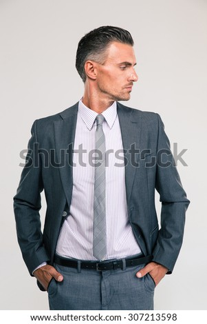 Portrait of a confident businessman looking away isolated on a white background - stock photo