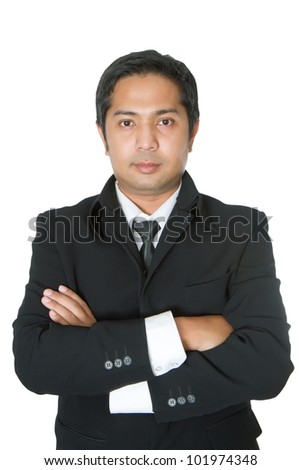 Portrait of a confident businessman with folded arms isolated on a white background
