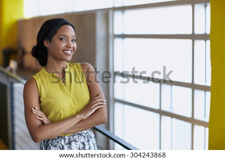 Portrait of a confident businesswoman at work in herglass office - stock photo