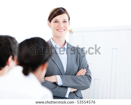 Portrait of a confident businesswoman doing a presentation in the office - stock photo