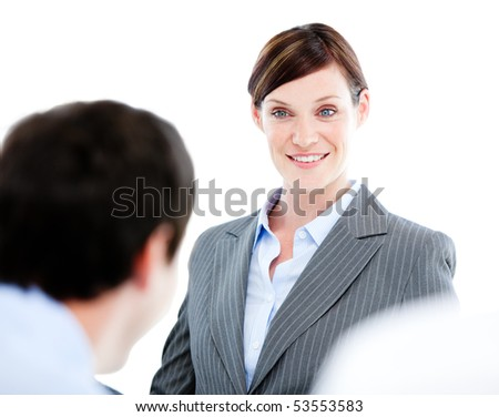 Portrait of a confident businesswoman talking at her colleague during a meeting in the office