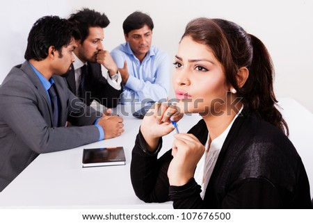 portrait of a confident businesswoman with her colleagues in the background - stock photo