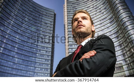 Portrait of a confident handsome businessman with folded arms
