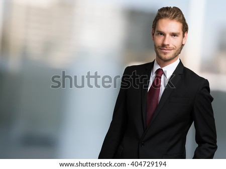 Portrait of a confident handsome young businessman - stock photo