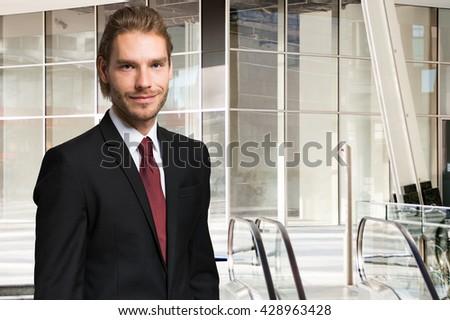 Portrait of a confident handsome young businessman - stock photo