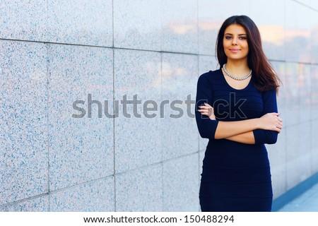 Portrait of a confident happy businesswoman - stock photo