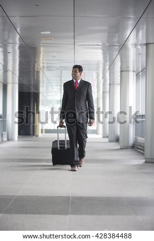 Portrait of a confident Indian businessman walking in the city.