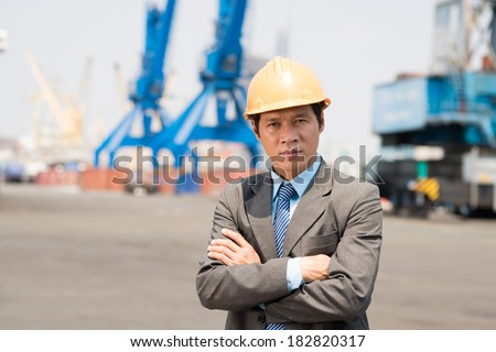 Portrait of a confident inspector looking at camera at port