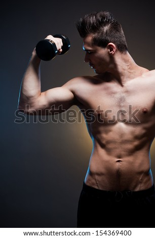 Portrait of a confident looking very lean fit young male athlete.
