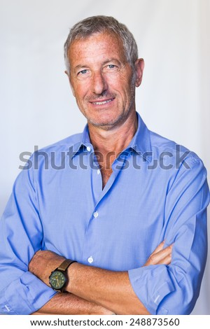 portrait of a confident mature handsome man smiling  - stock photo
