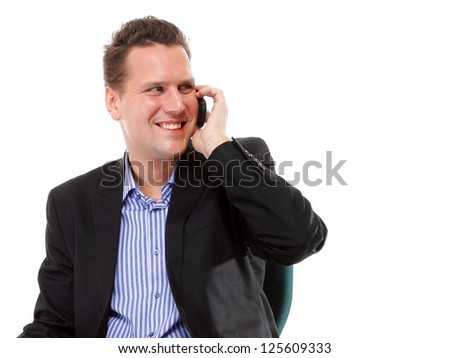 Portrait of a confident mature man speaking on his mobile and smiling